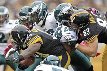 Pittsburgh Steelers running back Rashard Mendenhall (34) runs past Philadelphia Eagles strong safety Nate Allen (29) and defensive tackle Cedric Thornton (72) in the second quarter of an NFL football game in Pittsburgh, Sunday, Oct. 7, 2012. (AP Photo/Gene J. Puskar)