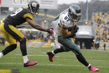 Philadelphia Eagles tight end Brent Celek (87)  gets past Pittsburgh Steelers free safety Ryan Mundy (29) for a touchdown after making a catch in the fourth quarter of an NFL football game in Pittsburgh, Sunday, Oct. 7, 2012. (AP Photo/Gene J. Puskar)