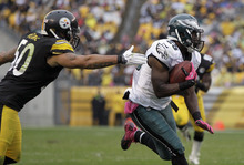 Philadelphia Eagles running back LeSean McCoy (25) evades Pittsburgh Steelers inside linebacker Larry Foote (50) on his way to a touchdown in the third quarter of an NFL football game in Pittsburgh, Sunday, Oct. 7, 2012. (AP Photo/Gene J. Puskar)