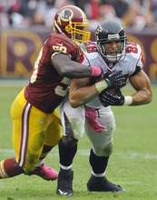 Washington Redskins inside linebacker London Fletcher, left, stops Atlanta Falcons tight end Tony Gonzalez during the second half of an NFL football game in Landover, Md., Sunday, Oct. 7, 2012. (AP Photo/Richard Lipski)