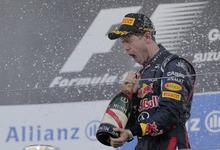 Red Bull driver Sebastian Vettel of Germany sprays champagne as he celebrates his win at the Japanese Formula One Grand Prix at the Suzuka Circuit in Suzuka, Japan, Sunday, Oct. 7, 2012. (AP Photo/Itsuo Inouye)