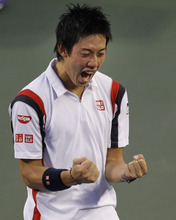 Japan's Kei Nishikori celebrates after winning over Canada's Milos Raonic during their final of the Japan Open tennis championships in Tokyo Sunday, Oct. 7, 2012. (AP Photo/Shuji Kajiyama)