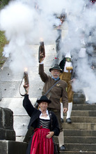 Bavarian riflemen and women in traditional costumes fire their muzzle loaders in Munich, southern Germany, Sunday, Oct. 7, 2012. Members of various shooting clubs of the region met for a salute on the last day of the famous Oktoberfest beer festival. (AP Photo/dapd/Lukas Barth)