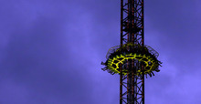 Visitors enjoy a ride with a free fall tower at the famous Bavarian