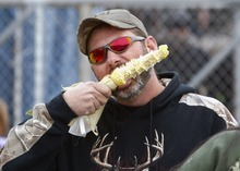 David Hansberger, of Alton, digs into a piece of BBQ corn Saturday October 6, 2012 during the 2012 Oktoberfest at St. Mary's Church in Alton, Ill. Hundreds turned out for the three-day event to partake in the great food and beer. (AP Photo/The Telegraph, Margie M. Barnes)  THE NEWS-DEMOCRAT AND THE POST-DISPATCH OUT