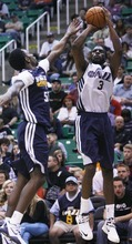 Kim Raff | The Salt Lake Tribune (right) DeMarre Carroll takes a jump shot as (left) Kevin Murphy defends during the Jazz Scrimmage at EnergySolutions Arena in Salt Lake City, Utah on October 6, 2012.