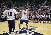 Kim Raff | The Salt Lake Tribune (left) Jazz players Alec Burks and Enes Kanter dance on the court during introductions before the Jazz Scrimmage at EnergySolutions Arena in Salt Lake City, Utah on October 6, 2012.