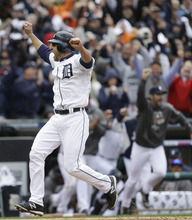 Paul Sancya | The Associated Press Detroit Tigers' Omar Infante scores the winning run in the ninth inning on a sacrifice fly by teammate Don Kelly in Game 2 of the American League division baseball series, Sunday, Oct. 7, 2012, in Detroit. (AP Photo/Paul Sancya)