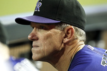 Colorado Rockies manager Jim Tracy watches the action on the field during a baseball game against the Arizona Diamondbacks Wednesday, Oct. 3, 2012, in Phoenix.  The Rockies defeated the Diamondbacks 2-1. (AP Photo/Ross D. Franklin)