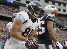 Denver Broncos tight end Joel Dreessen (81) celebrates his touchdown catch in the second quarter of an NFL football game against the New England Patriots Sunday, Oct. 7, 2012 in Foxborough, Mass.(AP Photo/Elise Amendola)