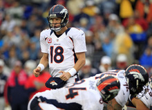 Denver Broncos quarterback Peyton Manning (18) reacts in the first quarter of an NFL football game against the New England Patriots Sunday, Oct. 7, 2012 in Foxborough, Mass. (AP Photo/Steven Senne)