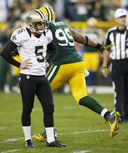Tom Lynn | The Associated Press Green Bay's Jerel Worthy, right, celebrates after New Orleans kicker Garrett Hartley missed a go-ahead field goal late in the fourth quarter.
