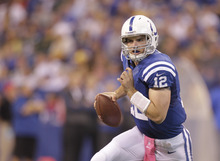 Indianapolis Colts quarterback Andrew Luck (12) runs during the second half of an NFL football game against the Green Bay Packers in Indianapolis, Sunday, Oct. 7, 2012. (AP Photo/Michael Conroy)