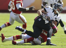 Baltimore Ravens tight end Dennis Pitta (88) is tackled by Kansas City Chiefs strong safety Eric Berry (29) during the first half of an NFL football game at Arrowhead Stadium in Kansas City, Mo., Sunday, Oct. 7, 2012. (AP Photo/Charlie Riedel)