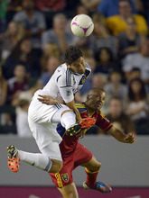 Los Angeles Galaxy's Omar Gonzalez, left, and Real Salt Lake's Alvaro Saborio battle for the ball during the first half of their MLS soccer match on Saturday, Oct. 6, 2012, in Carson, Calif. (AP Photo/Mark J. Terrill)