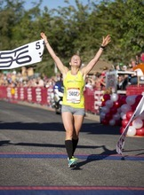 Amber Green, the first female finisher of the 36th annual St. George Marathon, crosses the finish line Saturday, Oct. 6, 2012.
