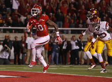 Scott Sommerdorf  |  The Salt Lake Tribune              Utah Utes wide receiver DeVonte Christopher (10) scores on an 18-yard TD catch against USC on Oct. 4, 2012.