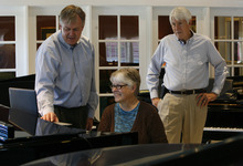 Scott Sommerdorf     The Salt Lake Tribune              Daynes vice president Kerwin Ipsen, left, works with customer Clara Neu as she tries out a computer that interfaces with one of the store's Steinways at Daynes Music Company in Midvale, Monday, October 1, 2012. Gerald