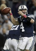 Chris Detrick  |  The Salt Lake Tribune Brigham Young Cougars quarterback Taysom Hill (4) throws the ball during the second half of the game at LaVell Edwards Stadium Friday October 5, 2012. BYU won the game 6-3.