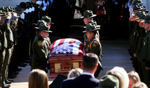 U.S. Border Patrol agents lift the casket holding slain agent Nicholas Ivie during the funeral at The Church of Jesus Christ of Latter-day Saints in Sierra Vista, Ariz., on Monday, Oct. 8, 2012.   (AP Photo/Arizona Daily Star,Mike Christy )  ALL LOCAL TV OUT; PAC-12 OUT; MANDATORY CREDIT