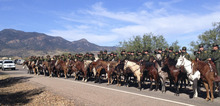 Mounted officers line the route during the funeral procession for slain U.S. Border Patrol agent Nicholas Ivie on Monday, Oct. 8, 2012, at The Church of Jesus Christ of Latter-day Saints in Sierra Vista, Ariz.  The head of the U.S. Border Patrol agents' union says the agent was killed when he  apparently opened fire on two colleagues thinking they were armed smugglers and was killed when they returned fire. (AP Photo/Brian Skoloff)