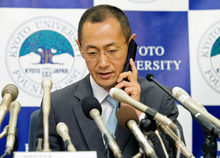 Kyoto University Professor Shinya Yamanaka receives a call from Japanese Prime Minister Toshihiko Noda to congratulate his winning of Nobel Prize during a news conference at Kyoto University in Kyoto, Japan, Monday night, Oct. 8, 2012. Yamanaka and British researcher John Gurdon won this year's Nobel Prize in physiology or medicine. (AP Photo/Kyodo News)