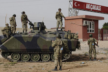 FILE - In this Sunday, Oct. 7, 2012 file photo, Turkish military station at the border gate with Syria, across from Syrian rebel-controlled Tel Abyad town, in Akcakale, Turkey. Syria and Turkey exchange fire across their troubled border for a sixth straight day, attacks that look increasingly like an intentional escalation by President Bashar Assad to send a message to his northern neighbor that it will pay dearly for supporting the rebels. (AP Photo, File)