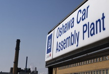 FILE-In this Monday, Sept. 17, 2012, file photo, a sign stands outside Oshawa's General Motors car assembly plant in Oshawa, Ontarrio. General Motors said Monday, Oct. 8, 2012,  it will hire as many as 1,500 workers to staff a new computer technology center in the Detroit suburb of Warren, Mich. GM is shifting computer work into the company from outside firms and plans to open four new technology centers in the U.S. Last month the company announced it would hire 500 people for a center in Austin, Texas.  (AP Photo/The Canadian Press, Michelle Siu)