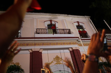 Venezuela's President Hugo Chavez greets his supporters at the Miraflores presidential palace balcony in Caracas, Venezuela, Sunday, Oct. 7, 2012.  Chavez won re-election and a new endorsement of his socialist project Sunday, surviving his closest race yet after a bitter campaign against opposition candidate Henrique Capriles.(AP Photo/Rodrigo Abd)