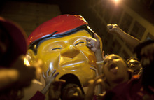 Supporters of Venezuela's President Hugo Chavez celebrate in downtown Caracas, Venezuela, Sunday, Oct. 7, 2012.  Chavez won re-election and a new endorsement of his socialist project Sunday, surviving his closest race yet after a bitter campaign against opposition candidate Henrique Capriles.(AP Photo/Ariana Cubillos)