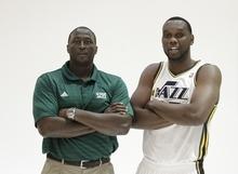 Utah Jazz head coach Tyrone Corbin and Utah Jazz's Al Jefferson (25) poses for a photograph during Jazz media day Monday, Oct. 1, 2012, in Salt Lake. (AP Photo/Rick Bowmer)