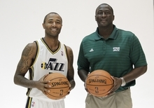 Utah Jazz head coach Tyrone Corbin, right, and Utah Jazz's Mo Williams poses for a photograph during Jazz media day Monday, Oct. 1, 2012, in Salt Lake. (AP Photo/Rick Bowmer)