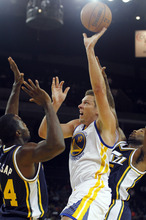 Golden State Warriors' David Lee, center shoots between Utah Jazz's Paul Millsap, left, and Mo Williams during the first half of a preseason NBA basketball game in Oakland, Calif., Monday, Oct. 8, 2012. (AP Photo/George Nikitin)