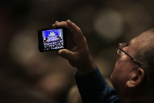 Scott Sommerdorf  |  The Salt Lake Tribune              A man makes a photo inside the Conference Center prior to the start of the afternoon session of the 182nd Semiannual General Conference, Saturday, October 6, 2012.