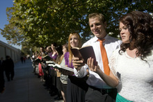 Kim Raff  |  The Salt Lake Tribune Greg Powell and Kenna Kupfer sing hymns to people walking to conference during the 182nd Semiannual General Conference of the LDS Church in Salt Lake City on Sunday, October 7, 2012.