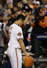 Baltimore Orioles starting pitcher Wei-Yin Chen, of Taiwan, acknowledges fans as he walks off the field after being relieved in the seventh inning of Game 2 of the American League division baseball series against the New York Yankees on Monday, Oct. 8, 2012, in Baltimore. (AP Photo/Alex Brandon)