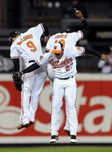 Nick Wass | The Associated Press Baltimore Orioles' Nate McLouth, left, Endy Chavez (27) and Adam Jones celebrate winning Game 2 of the American League division baseball series against the New York Yankees on Monday, Oct. 8, 2012, in Baltimore. Baltimore won 3-2. (AP Photo/Nick Wass)