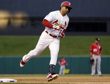 St. Louis Cardinals' Carlos Beltran rounds the bases after hitting a solo home run during the sixth inning in Game 2 of baseball's National League division series against the Washington Nationals, Monday, Oct. 8, 2012, in St. Louis. (AP Photo/Jeff Roberson)