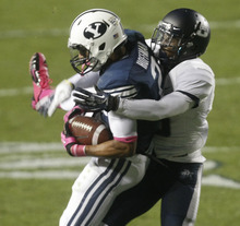 Chris Detrick  |  The Salt Lake Tribune Brigham Young Cougars wide receiver Cody Hoffman (2) makes a catch past Utah State Aggies cornerback Rashard Stewart (6) during the first half of the game at LaVell Edwards Stadium Friday October 5, 2012. BYU is winning the game 6-3.