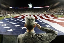 Chris Detrick  |  The Salt Lake Tribune Trevor Jax, and other members of the BYU Air Force ROTC, display an American flag before the game against USU at LaVell Edwards Stadium Friday October 5, 2012.