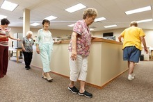 Trent Nelson     The Salt Lake Tribune Doctor of Physical Therapy Amanda Thompson, left, leads students in a class aimed at helping people 60 and over with fall prevention in Layton on Tuesday, August 7, 2012. Left to right are Thompson, Carma Kerbs, Nola Toole, Bonnie Middleton and Annette Leavitt, who are doing a heel-to-toe exercise. Davis County Health Department's Senior Services has announced the workshop, called Stepping On, being offered in the county.