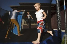 Leah Hogsten  |  The Salt Lake Tribune Hagen Dickinson, 4, who suffers from moderate to severe autism, can run around the trampoline for hours, keeping himself entertained. But he needs constant supervision to prevent him from wandering away.