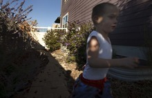 Leah Hogsten  |  The Salt Lake Tribune Hagen Dickinson, 4, who suffers from moderate to severe autism, needs constant supervision when he plays outside to ensure his safety and that he does not escape from the yard.