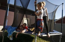 Leah Hogsten  |  The Salt Lake Tribune Dickinson sisters Bela, 12, Fe', 10, and brother Isaac, 6, share in their duties of watching out for their autistic brother Hagen, 4. Children with autism typically wander because they feel anxious or like to explore.