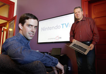 Al Hartmann  |  The Salt Lake Tribune i.TV Co-founders  Justin Whittaker, left, and Brad Pelo in front of their big screen tv with the Nintendo TVii interface running on it.  i.TV is a  Provo software company that makes software for interactive television. They were hired by Nintendo to make the interactive television service called Nintendo TVii that will come with the upcoming Nintendo Wii U gaming console. It's a service in which you will be able to watch television on demand through your gaming console and also be able to interact with other people online while watching the tv.