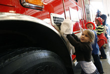 Francisco Kjolseth  |  The Salt Lake Tribune Sydney, 4, Tyler, 6, and Madison Hill, 8, from left, participate in the ceremonial washing of a fire truck in a new home as the Unified Fire Authority opens its new fire station in Big Cottonwood Canyon on Tuesday, Oct. 9, 2012, just below Brighton Resort and the start of Guardsman Pass.