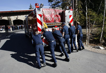 Francisco Kjolseth  |  The Salt Lake Tribune As it has become tradition, fire crews push a fire truck (with a little help from the engine) into its new home in the mountains. The Unified Fire Authority opened its new fire station in Big Cottonwood Canyon on Tuesday, Oct. 9, 2012, just below Brighton Resort and the start of Guardsman Pass.