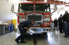 Francisco Kjolseth  |  The Salt Lake Tribune Jared Norton wipes down a fire truck following a ceremonial wash marking a new beginning.  The Unified Fire Authority opened its new fire station in Big Cottonwood Canyon on Tuesday, Oct. 9, 2012, just below Brighton Resort and the start of Guardsman Pass.