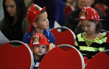 Francisco Kjolseth  |  The Salt Lake Tribune Cameron Hill, 2, botttom, plays with his new fire helmet, along with siblings Tyler, 8, and Madison, 8, as the Unified Fire Authority opens its new fire station in Big Cottonwood Canyon on Tuesday, Oct. 9, 2012, just below Brighton Resort and the start of Guardsman Pass. Cameron's dad of Zwick Construction was involved in the construction of the new building.