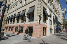 Paul Fraughton | The Salt Lake Tribune The Crandall Building in downtown Salt Lake City has had its foundation returned to show the original sandstone. It now houses a Starbucks Coffee where there was originally a tea room in the 1900s.  Thursday, October 4, 2012